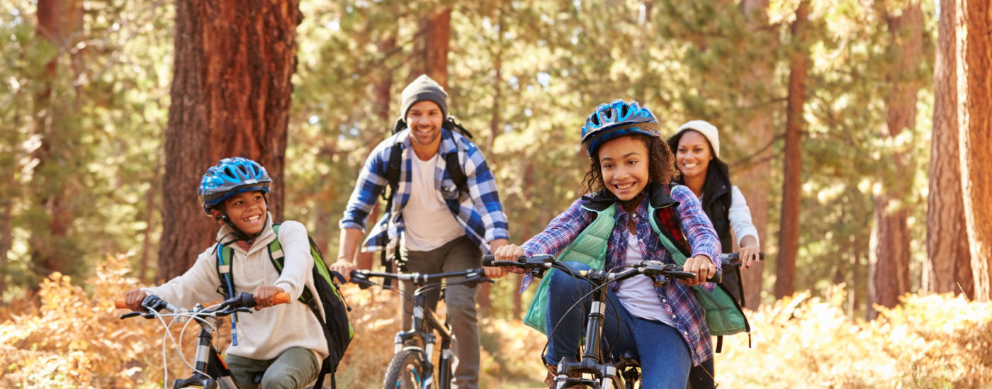 photodune-16331827-african-american-family-cycling-through-fall-woodland-m-e1465504987318